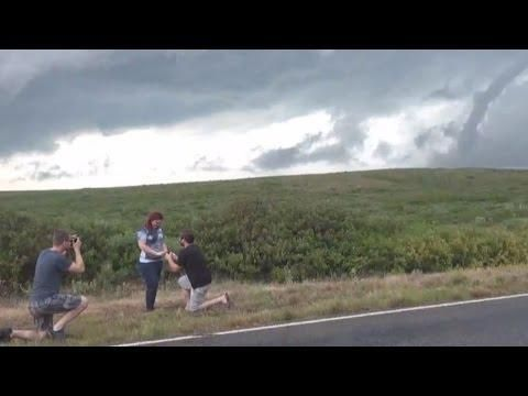 Storm Chaser Proposes to Girlfriend With Tornado Behind Them!