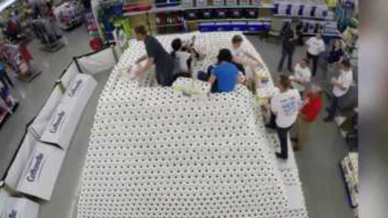 Clark team up to smash Guiness World Record, building a toilet paper pyramid