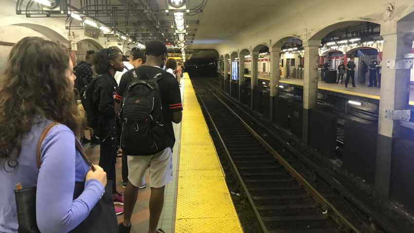 A commuter who was trapped between MBTA train, platform has been freed