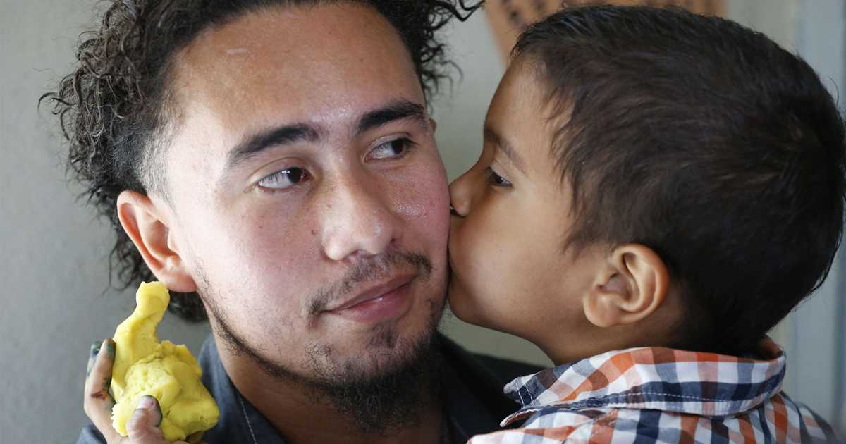 After months of family separation, immigrant children covered in fathers' hugs, kisses