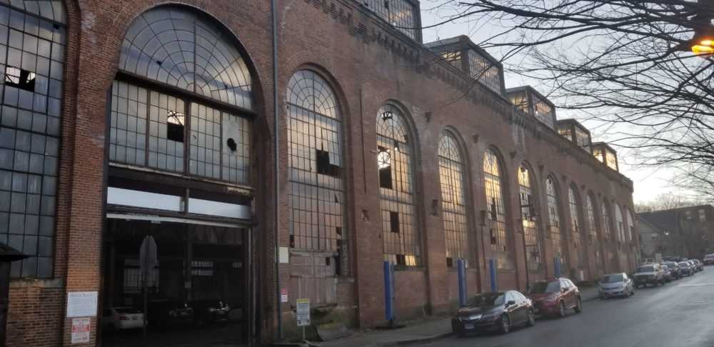 Developers selected for two key parcels at Clipper Mill, including the historic Tractor Building