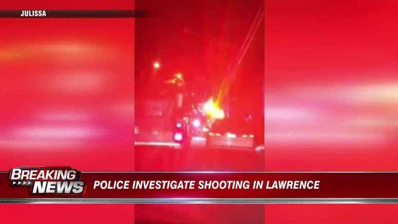 Woman hospitalized following shooting in Lawrence