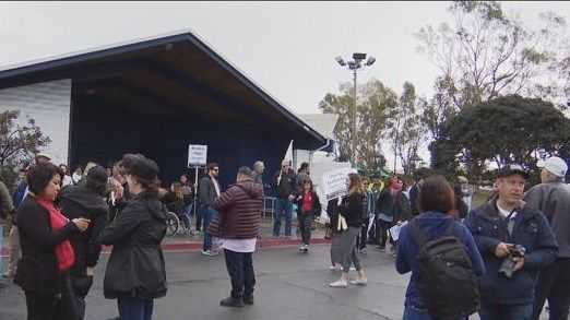 Local group and counter protestors clash on migrant solidarity