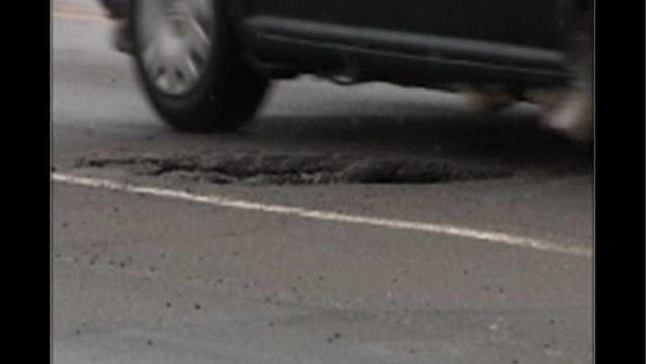 "Ohio woman ticketed for ""dodging potholes"""