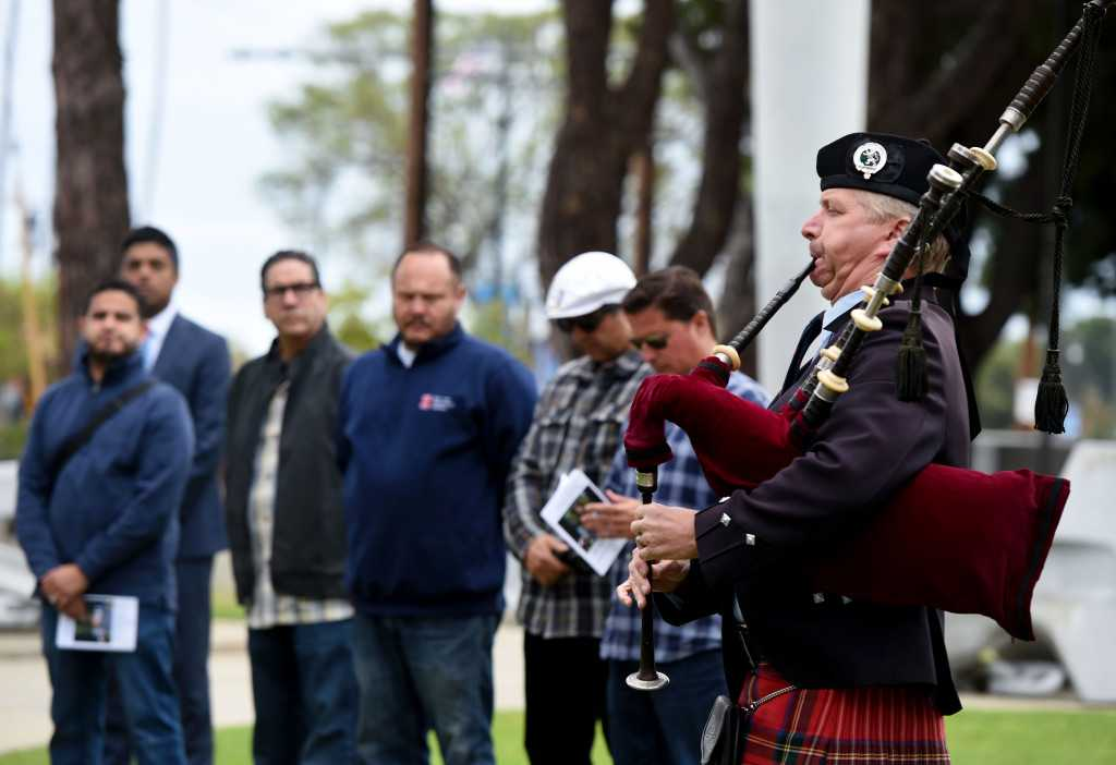 Port of LA's dock workers gather to honor their fallen on a day when one more peer was lost