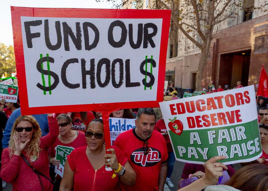 Public schools get record cash but are still going broke