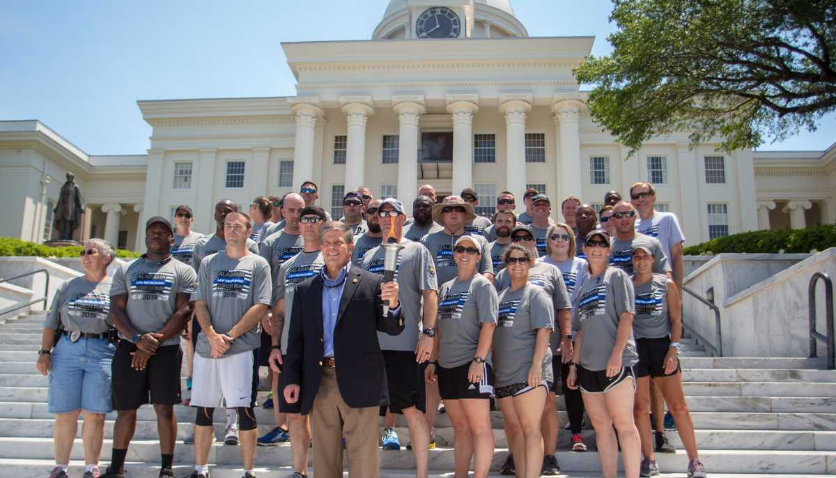 'Flame of Hope' travels through Montgomery on way to Special Olympics opening ceremonies