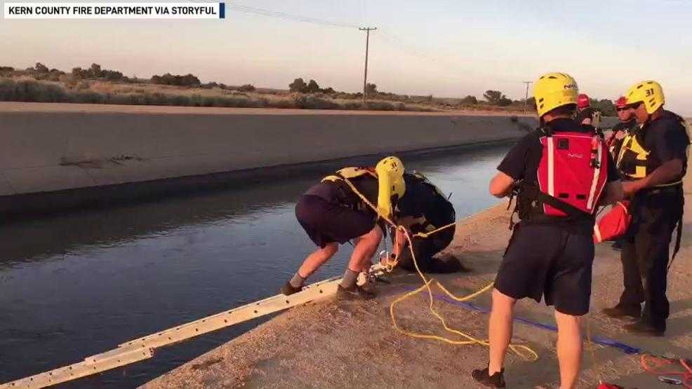 Firefighters rescue man who drove car into California canal