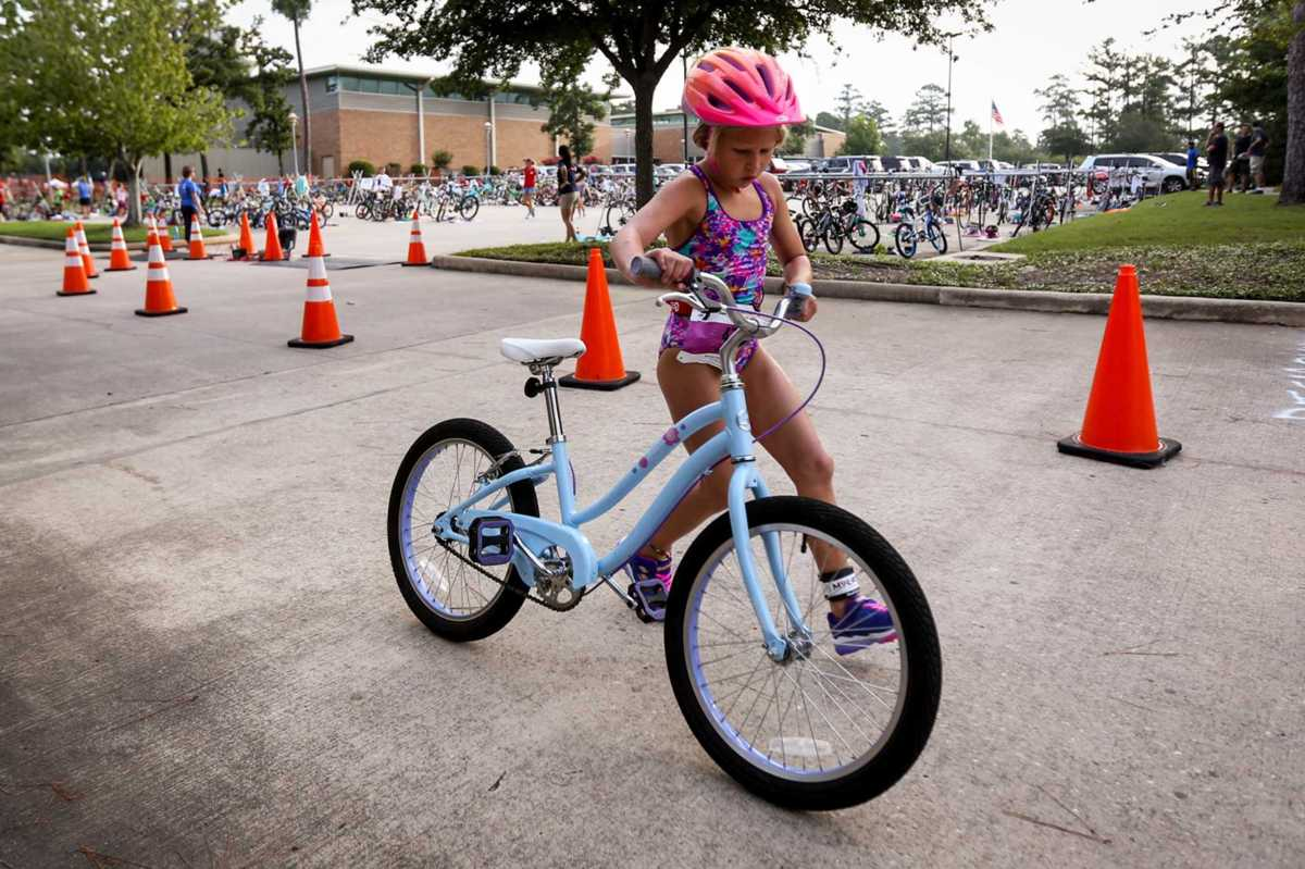 Children get a chance to test their triathlon skills at the Woodlands Family YMCA triathlon on Saturday
