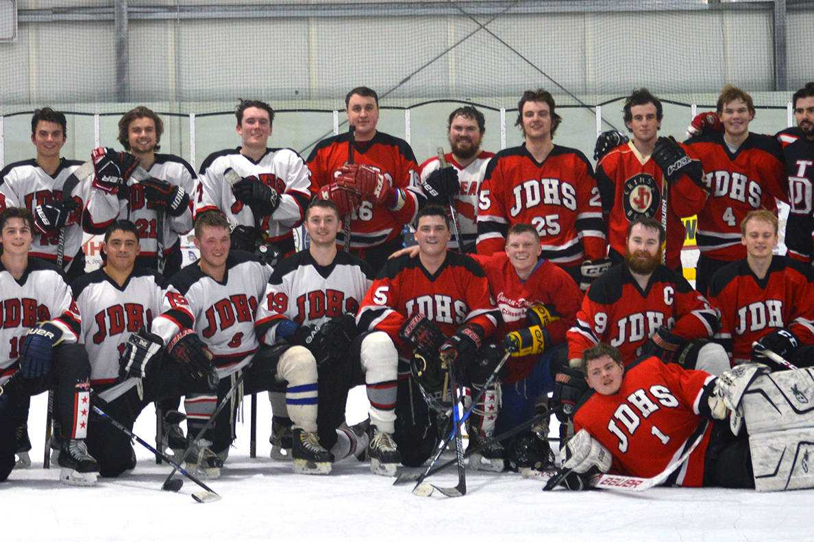 Photo: JDHS hockey alums square off