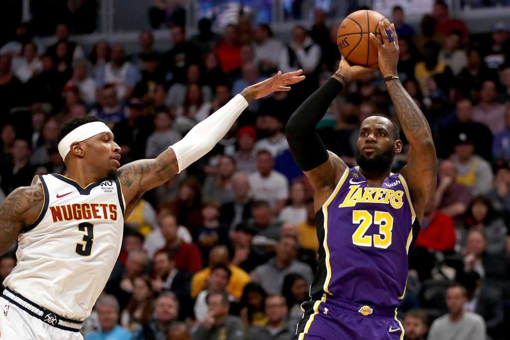 LeBron James, Anthony Davis help Lakers edge Nuggets in OT