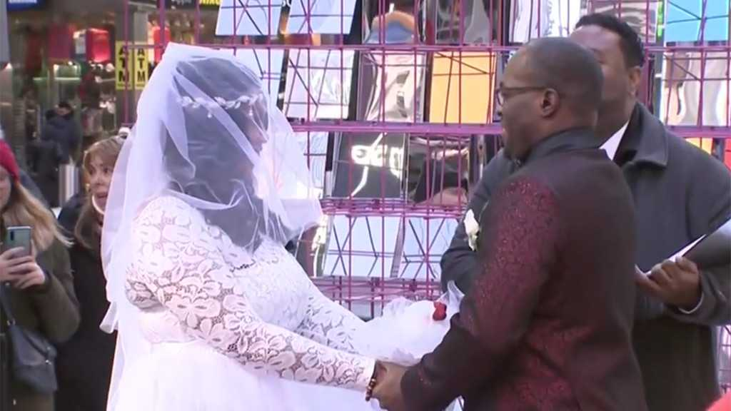 Couples Celebrate Valentine's Day With Weddings, Proposals And Vow Renewals In Times Square