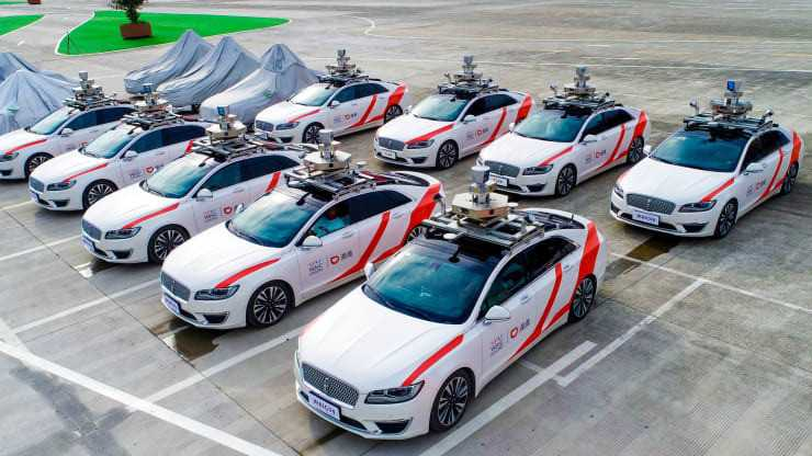 These driverless cars in Shanghai form the world's first 'robotaxi' fleet